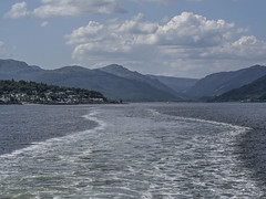 Looking down the Holy Loch, leaving Dunoon - July 2017 (GOR44Photographic@Gmail.com) Tags: water sea clyde boat ferry holy loch scotland argyll cowal firthofclyde mountains hills wake cloud houses gor44 olympus omdem5 panasonic 45150mmf456