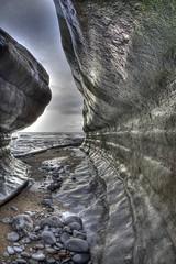 Through (pauldunn52) Tags: rock beach tunnel trench wave worn eroded southerndown wales glamorgan heritage coast