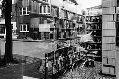 Weird Morph (Dennis Stachel / atmospheria fotografie & design) Tags: street morph reflection black white still books windows frame