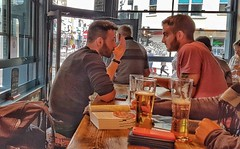 A Chat Over a Pint. (ManOfYorkshire) Tags: guys beards ontrend share pint pints drink drinks pub brighton sussex tattoo hair jumper mate mates bestfriends table chat conversation candid goodlooking youth men man