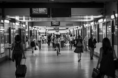 At the train station (Ludovic Enkler) Tags: train station blackwhite monochrome people persons kitty kitten lights underground canon 50mm f14 70d floor reflection bike bicycle bags