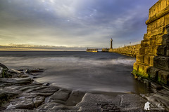 Whitby pier (Morty1884) Tags: canon whitby seascape piers long exposure 6d east sea beach lighthouse sunset sky northeast yorkshire