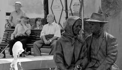 Similarity between front- and background (Maarten Kleijkamp) Tags: senioren people mensen overeenkomst statue sculpture lanjaron spain andalusie spanje inhabitants similarity bnw bw street plein
