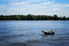 Solitude is a solitary boat floating in a sea of possible companions... (~ cynthiak ~) Tags: 365 365days 3652017 2017 july july2017 selfportrait 204365 img9752 michigan girlsweekend werehere hereios lake water tube floatingaway floating