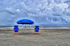 Just some chairs and an umbrella (Terri McClanahan) Tags: galvestontexas beach beachchairs blue clouds rainclouds ocean gulfofmexico sand beachumbrella