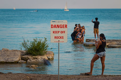 Danger - Keep Off Rocks (A Great Capture) Tags: rocks water lakeontario woodninebeazb people ontario lake keepoffrocks warningsign toronto beaches summertime summer humannature sign danger beach agreatcapture agc wwwagreatcapturecom adjm ash2276 ashleylduffus ald mobilejay jamesmitchell on canada canadian photographer northamerica torontoexplore été 2017