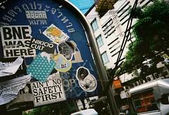 Ain't No Safety First (35mm) (jcbkk1956) Tags: bangkok thailand street signs thonglo vivitar vivitar35ee kodak ultramax400 rangefinder analog stickers graffiti ekkamai 35mm worldtrekker uc400