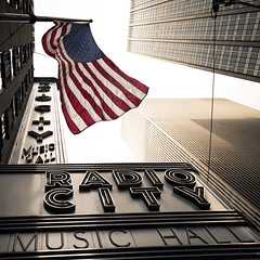 Radio City Music Hall, New York City (Darren LoPrinzi) Tags: 5d canon5d manhattan ny nyc newyork newyorkcity urban canon city miii sign marquee radiocity radiocitymusichall iconic midtown theater flag americanflag usflag buildings skyscrapers