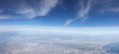 Flying Out of California (artofjonacuna) Tags: california airplane panoramic landscape cityscape sky clouds