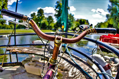rusty bike on a houseboat (I was blind now I see!) Tags: rust rusty bike handlebars grips gear selector trees boat houseboat clouds bokeh colour post processed railings water cambridge cam river sky blue