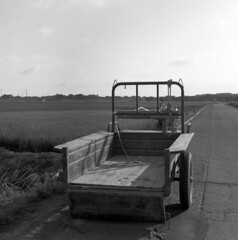 Trailer tractor (odeleapple) Tags: yashica mat 124g yashinon 80mm neopan100acros film monochrome bw trailer tractor paddy field