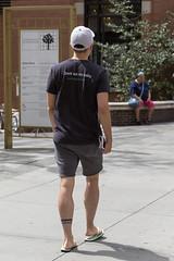 094A9636 v2 (Wheels Down) Tags: twink candid nyc streetphotography flipflops hottie tattoo legs feet cap tshirt