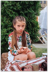 Hutsul girl with homespun towels. (Ігор Кириловський) Tags: slr nikonf5 af zoomnikkor 28105mmf3545d film kodak colorplus200 promaster spectrum7uv stpeter fair chernivtsi ukraine hutsul girl homespun towels vyshyvanka blonde portrait