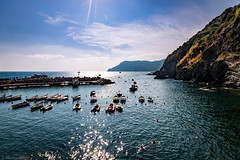 The shimmering sea (Anthony P26) Tags: boat category cinqueterre italy places seascape transport travel vernazza travelphotography landscapephotography transportation harbour harbourwall coast coastline sigma1020mm canon70d canon seashore coastal bay inlet rocks cliffs hills hillside italian liguriansea liguria mediterranean clouds whiteclouds blueskies bluesky sunlight shimmeringlight summer outdoor