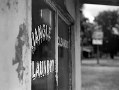 Dirty Laundry (macromary) Tags: 120 120film analog 105mm f24 florida pentax6x7 mediumformat foma fomapan fomapan100 blackwhite analogphotograph bokeh bw blackandwhitefilm filmcamera film mechanicalcamera vintage vintagecamera nwflorida urbex taylorcounty laundry abandoned perry trianglelaundry