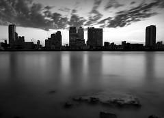 Docklands (PeskyMesky) Tags: london blackandwhite longexposure riverthames docklands canarywharf bw monochrome architecture