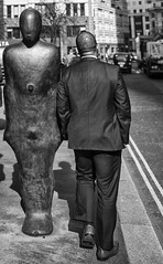 two eggheads (keith ellwood) Tags: street london city commuters tonal black white reflections