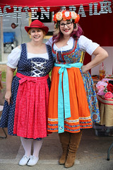 Colorful Aprons (wyojones) Tags: texas tomball tomballgermanheritagefestival costume attire festival german people woman dresses aprons blondehair purplehair boots shoes glasses beautiful pretty wyojones