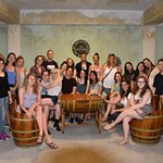 Honors students pose together in a wine cellar that they visited in Samos.