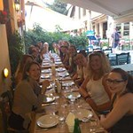 Honors student enjoy their welcome dinner with the Athens Centre on their first night in Greece.