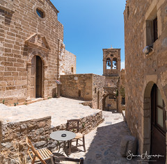 Monemvasia - Greece (Stavros A.) Tags: monemvasia travel greece greek table chairs lakonia city peloponnese europe church orthodox medieval byzantine narrowstreet path paved squareformat bells mani summer blue buildings architecture traditional historic tourism outdoor exterior mediterranean nikon nikond750 tokina1628 μονεμβασιά λακωνία πελοποννησοσ ελλάδα μάνη