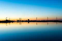 Reflecting Industry (Nikonierer) Tags: denmark copenhagen goldenhour reflection smooth amagerstrand sea beach night light sunset outdoors nature landscape water sky dawn industry