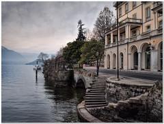 Tremezzo (Hugh Stanton) Tags: steps lake hotel dawn marina