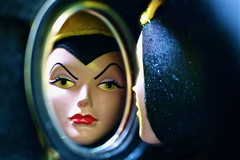 "Mirror, mirror… - Macro Monday - ""Queen"" (Explore Aug 1/17) (not beck) Tags: macromonday queen mirror disney snowwhite evil face lipstick crown enemy magic doll witch"