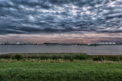 Antwerp Port (Jean Pauwels) Tags: sky landscape lake sunset water nature river travel light cloudy tree grass port dawn cloud weather storm agriculture panoramic outdoors horizontal no person antwerp jeanpauwels