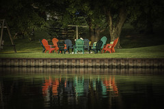 a splash of color awaits the family (TAC.Photography) Tags: chairs color plastic firepit beach summer cool water reflections waterreflections polarizer tomclarkphotographycom tacphotography tomclark