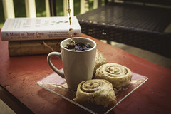 Simple Pleasures (miss.interpretations) Tags: cinnamonrollspastries sweettreats coffeemug coffee pouringcoffee coffeestream droplets books redbench patio cozy afternoon evening homecomforts reading