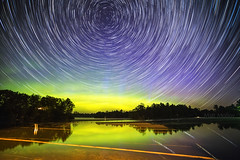 Active Night (Matt Molloy) Tags: mattmolloy timelapse photography timestack photostack movement motion colourful night sky stars trails lines circles polaris northstar auroraborealis northernlights green glow water reflection trees house haskinspoint littlecranberrylake seeleysbay ontario canada landscape nature lovelife