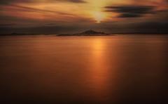 WestCoast Sunset (Cederquist Christoffer) Tags: cederquistsunsetdawnwatereveningdusksunbeachreflectionseaoceanseascapesilhouettelandscapeskyseashorebacklitlakenaturemoodyshadesredorangelongexposureswedensaltwatersaltfreebeautyisland
