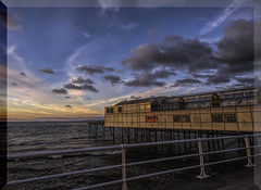 Down at the pier Aberystwyth (Elaine Delworth) Tags: sunset pier clouds ocean