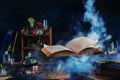 Flying magical book with smoke (Dina Belenko) Tags: magic book open symbol dark mystery smoke black literature wisdom concept education glowing idea learning reading religion science spirituality text fantasy halloween art brochure business illuminated information page spiritual bright imagination scary fairy tale wizard spell stilllife witch enchanted flying levitation bottle potion shelf table contrast spooky alchemy study