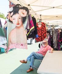 Flea Market Vendor (UrbanphotoZ) Tags: vendor fleamarket blouses relaxed bearded smiling shades asian woman flowers hair butterfly arsenault upperwestside manhattan newyorkcity newyork nyc ny