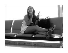 Airport people n. 2 (Franco & Lia (on/off)) Tags: street fotografiadistrada photographiederue olbia sardegna sardinia airport costasmeralda biancoenero noiretblanc blackandwhite mobile phone girl