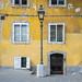 A well worn yellow wall in Ljubljana.