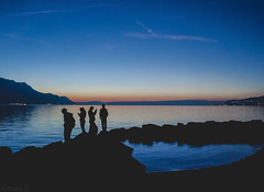 Silhouettes (Mad Physics Guy with a Camera) Tags: switzerland swiss suisse schweiz vaud chillon chateau sunset dusk twilight silhouette people sky mountain hill horizon blue dark night lakegeneva lacleman silhouettephotography