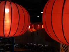 The Chinese Restaurant (Steve Taylor (Photography)) Tags: chinese restaurant lamps plate spoon bowl bottles winerack art architecture building chair table black red orange fabric wood asia city singapore clarkequay