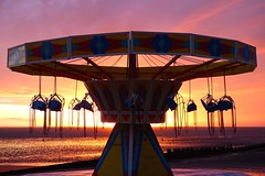 Carousel Sunrise (Peanut1371) Tags: carousel sunrise cleethorpes swing beach sky