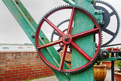 wheel and cogs (jimj0will) Tags: machinery mechanism cogs red green iron industrial
