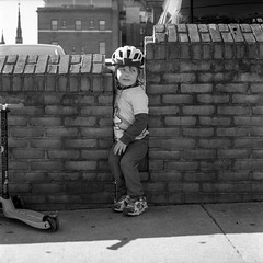 (patrickjoust) Tags: tlr twin lens reflex 120 6x6 medium format black white bw film blancetnoir blancoynegro schwarzundweiss manual focus analog mechanical patrick joust patrickjoust discontinued expired usa us united states north america estados unidos kid boy llewelyn mount mt vernon baltimore maryland md scooter parking lot