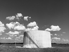 Texas Temples (happiness is...photography) Tags: oil tank black white clouds landscape stairs shadows stark temple texas tx tejas industrial somewhere nowhere road
