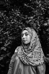 intrigue. (ari_lim) Tags: bw portrait hijab friend olympus outdoor nature monochrome youth lightroom