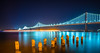 oakland bay bridge views near san francisco california in the evening (DigiDreamGrafix.com) Tags: bridge night bay oakland sanfrancisco insanfrancisco color lights blue colorful perspective sky beautiful reflection travel park outdoors nature water landscape architecture building city downtown urban scenery clouds coast scenic shore tourism skyline architectural buildings california