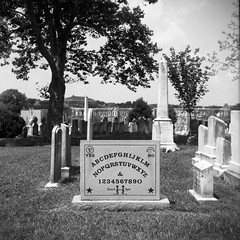 (patrickjoust) Tags: elijah bond ouija board greenmount cemetery tomb tombstone grave stone abcdefghijklmnopqrstuvwxyz tlr twin lens reflex 120 6x6 medium format black white bw home develop discontinued expired film blancetnoir blancoynegro schwarzundweiss manual focus analog mechanical patrick joust patrickjoust baltimore maryland md usa us united states north america estados unidos urban street city trees row house