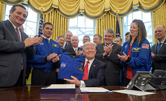President Trump holds NASA flight jacket