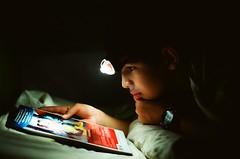 late nights (DT278 Photography) Tags: reading comicbook night darkness light flashlight late portrait people colorfilm filmnotdead film filmgrain minoltacolors minolta7000 minolta 50mm17 50mm boy kodakfilm kodacolor kodak 200iso