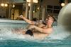 mies laskee vesiliukumäkeä (VisitLakeland) Tags: family spa fun children child parents play water splash kylpylä pool allas vesi perhe vahemmat lapset tyttö poika girl boy woman man vesileppis leppävirta finland lakeland